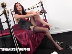 Watch hot Milf Jane slip her sexy long legs inside a pair of silky nylon stockings and then slowly put her delicate feet inside high heels