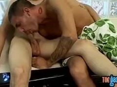 Toe sucking twinks suck and fuck wildly in hot threesome