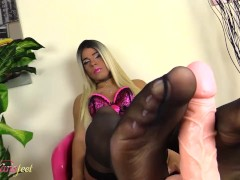 Blonde shemale does a footjob with her feet in black pantyhose