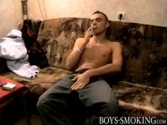 Chain smoking cutie Brad makes his monster cock launch cum