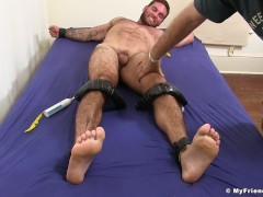 Hairy hunk restrained before cock tickling by deviant