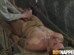 Restrained submissive guy gives footjob to his master