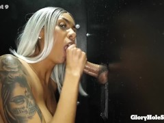 TALL WIFE SUCKS 12 STRANGERS COCKS AT THE GLORYHOLE