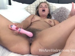Ulrikke masturbates in bed with her pink vibrator
