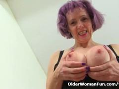 English granny Tigger lifts up her tartan skirt for pleasure