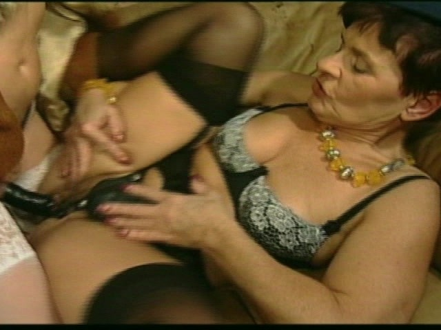 image Two lesbians one leg in pussy