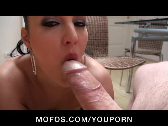 Big tit brunette milf gives blowjob