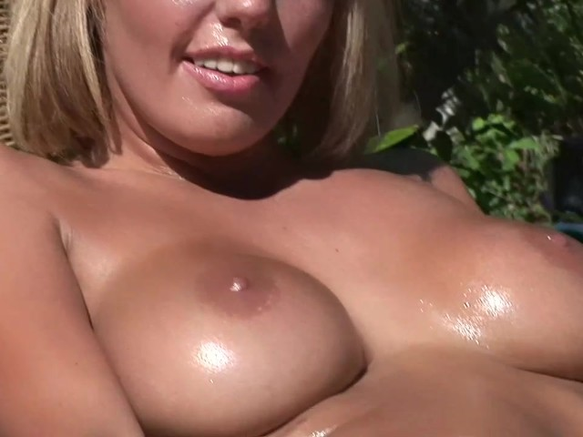 Beautiful blonde plays with a machine 8