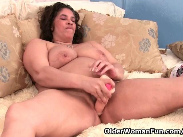 image Granny with milk leaking nipple fucks a dildo
