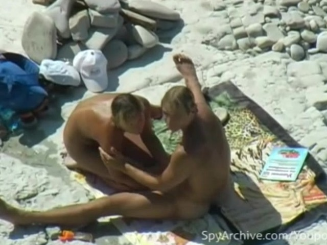 couple on the beach having sex