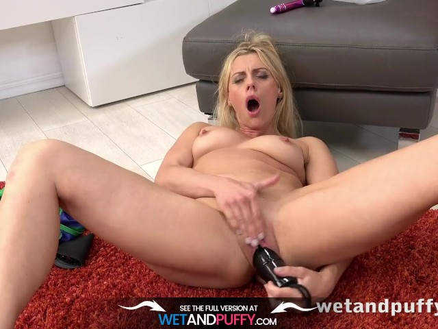 Wetandpuffy milf wrestles a monster dildo