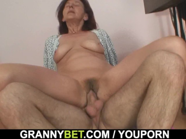 image Sewing granny enjoys riding young cock