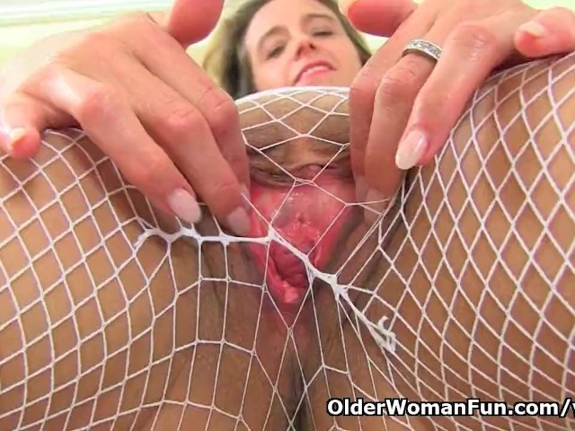 image English milf caz wears white fishnet tights and no knickers