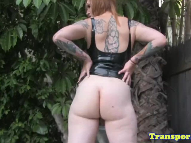 image Tattooed latex tgirl pulling hard cock solo