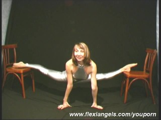 Flexible cutie close to shiny outfit