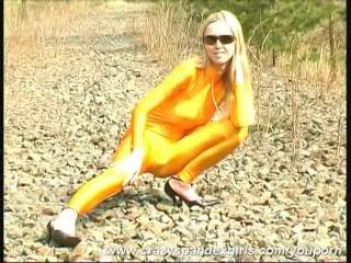 Blonde unfocused strips alfresco in spandex