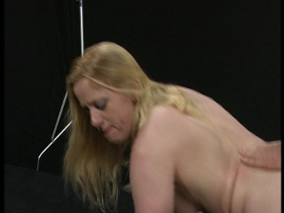 Pale blonde girl takes it from behind