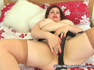 English milf Vintage Fox is stripping off
