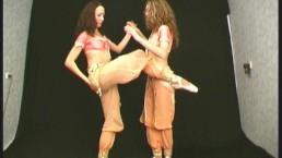 Two ballerinas shows flexible...