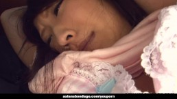 Bound and blindfolded Asian...