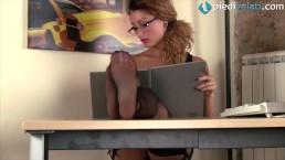 Redhead secretary in stockings...
