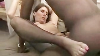 Horny bitch fucking a black cock and giving head