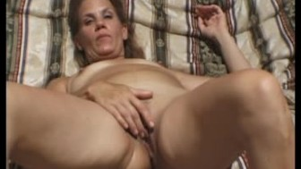 Attractive MILF strips and fucks
