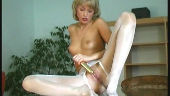 Blonde nylon Babe Betti with Dildo