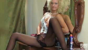Hot babe playing with pantyhose