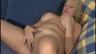 Using her own fingers to masturbate