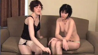Two girls playing games and stripping