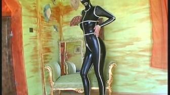Fullbody dressed in black latex