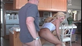 Sexy blonde cooking in the kitchen