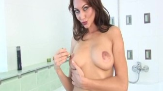 busty babe takes a shower