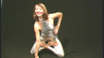 Flexible cutie in shiny outfit