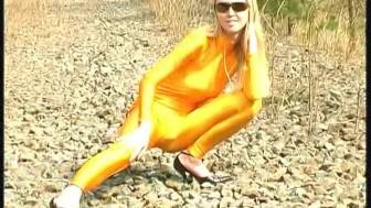 Blonde girl strips outdoor in spandex