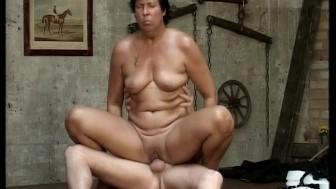 Grandma takes a cock on a table