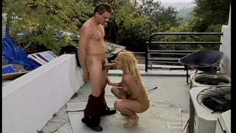 Julie Night sucks big Dick on terrace