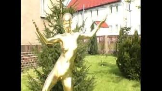 Crazy naked golden statue