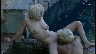 Hot blondes making a splash in the hot tub