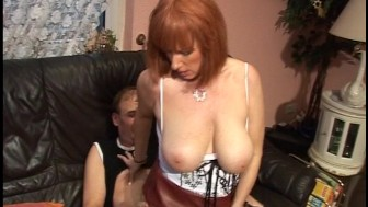 Redhead with giant tits gets busy