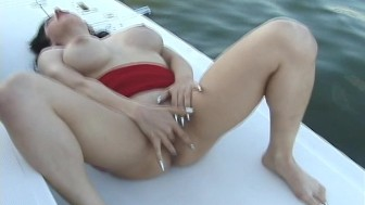 Hot brunette bangs herself on a boat