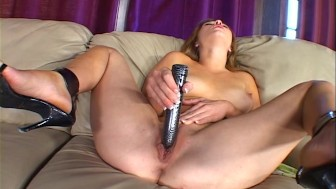 Sucking and inserting a big BLACK dildo (clip)
