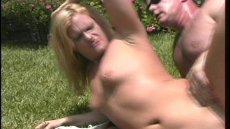 Fucking outdoors on the grass in the ass