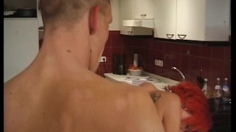 Sexy red-head gets wild in the kitchen (Clip)