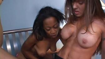Hot interracial lesbian strapon fuck