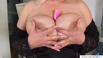 Big titted blonde fucks and sucks her dildo.