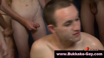 Twink takes bukkake shower after gangbang