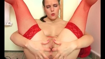 Leggy brunette masturbates in fishnet stockings