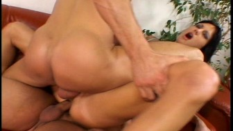 Beautiful brunette in corset fucked hard by two guys